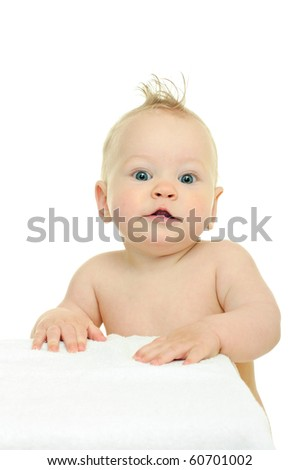 eight month baby leans his hands against white surface