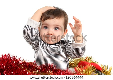 Eight months baby inside a box with christmas ornaments in a white background