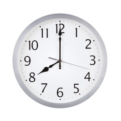 Eight o'clock on the round clock dial