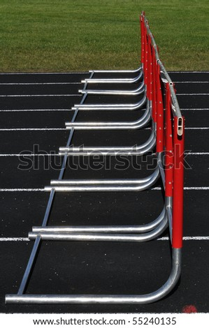 Eight Red Hurdles on a Black Track