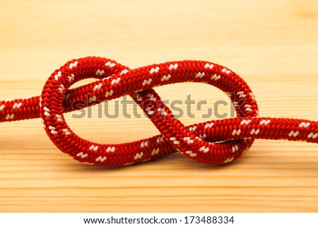 eight rope knot on wooden table