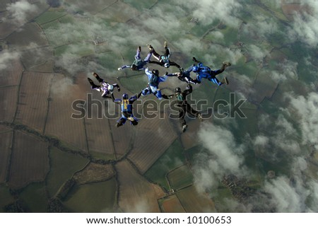 Eight skydivers building a formation