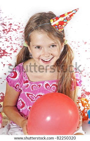 eight year old girl with party hat and trumpet on a children's festival