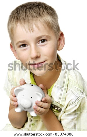 eight years old boy with big piggy bank isolated on white