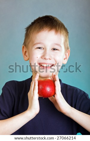 eight years old boy with fresh apple