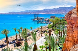 Eilat is a famous Israeli resort city with beautiful sandy beaches, hot sun and clear blue skies, surrounded by stunning mountains and desert scenery. It is very popular tropical getaway for tourists