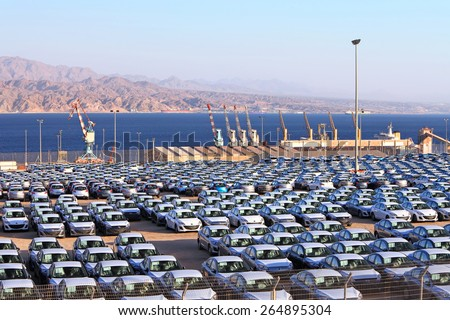 EILAT, ISRAEL - MARCH 17, 2015 : Cargo port and new cars. Eilat port is located on the coast of the Red Sea gulf opposite to Jordan\'s cargo port. Red sea, Eilat, Israel  on March 17, 2015