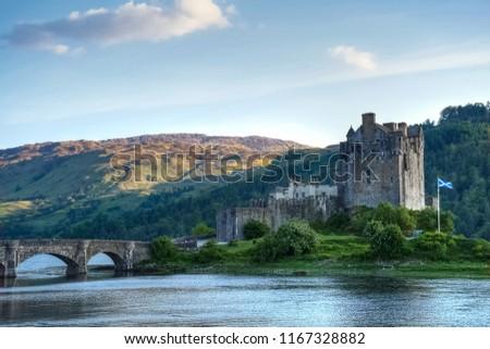 Eilean Donan castle at dusk, under a clear sky, Kyle of Lochalsh, Scotland, UK