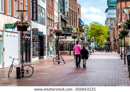 Eindhoven, Netherlands - May 24, 2015: People walking in the Eindhoven main commercial street. It is one of the most famous shopping street in the city with a plenty of stores, bars and clubs