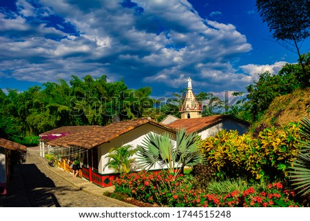 Photo of  eje cafetero colombia lanscape mountains typical sky clouds bamboo houses coffee tourism quindio salento cocora andes volcano