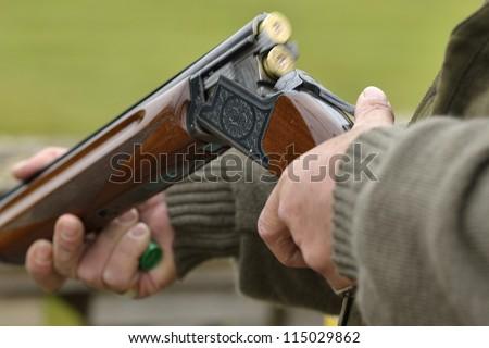 ejecting a spent carttridge from a shotgun