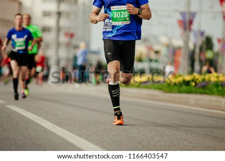 Ekaterinburg, Russia - August 5, 2018: male runner in compression socks running city in Europe-Asia Marathon #1166403547