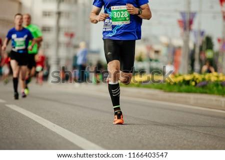 Ekaterinburg, Russia - August 5, 2018: male runner in compression socks running city in Europe-Asia Marathon #1166403547