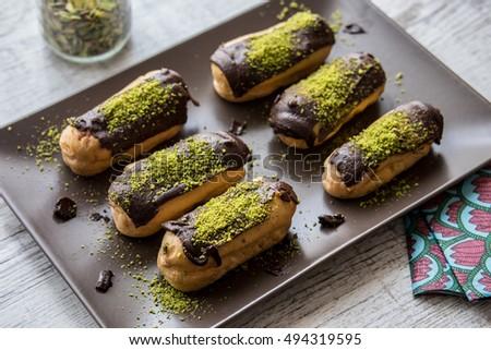 Ekler Pasta / Chocolate Donut with pistachio powder Stok fotoğraf ©