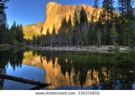El Capitan mountain seen at sunset across the Yosemite river, Yosemite national park, California, USA