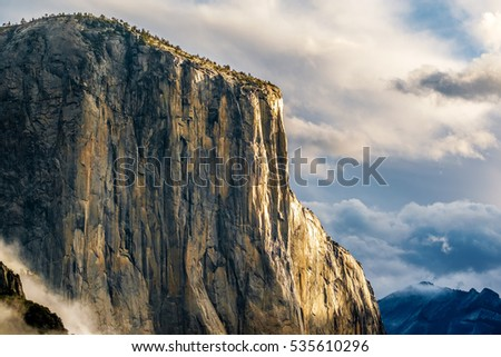 El Capitan rock close-up in Yosemite National Park Valley at cloudy autumn morning from Tunnel View. Low clouds lay in the valley. California, USA