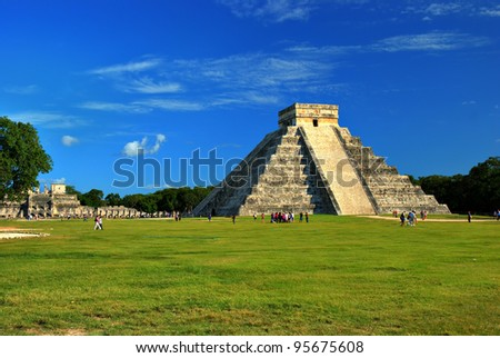 El Castillo (Pyramid of Kukulcan) in Chichen Itza, Quintana Roo, Mexico. Mayan ruins  near Cancun considered one of the seven wonders of the world. The Temple of Warriors is in the background.
