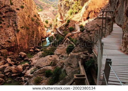 El Chorro is an enchanting place with stunning natural scenery in Andalucía, Spain. The main attraction of El Chorro is El Caminito del Rey walkway, which is depicted in this photo
