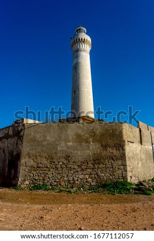 El Hank Lighthouse constructed in 1916, 50 m tall, abandoned facility.  - Casablanca, Morocco, taken in Dec 2019. Photo stock ©