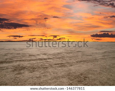 El Mirage dry lake with sunset sky in California's Mojave Desert.