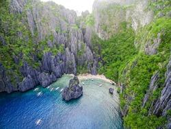 El Nido, Palawan, Philippines, aerial view of boats and karst scenery at Secret Lagoon beach.