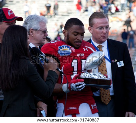 EL PASO – DECEMBER 31:  DeVonte Christopher is presented with the John Folmer Most Valuable Special Teams Player trophy at the Sun Bowl on December 31, 2011 in El Paso, Texas.