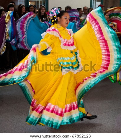 EL PASO – DECEMBER 26:  Mexican Folkloric Dancers perform at the El Paso Int'l Airport during the Notre Dame football teams arrival for the Sun Bowl on December 26, 2010 in El Paso, Texas.