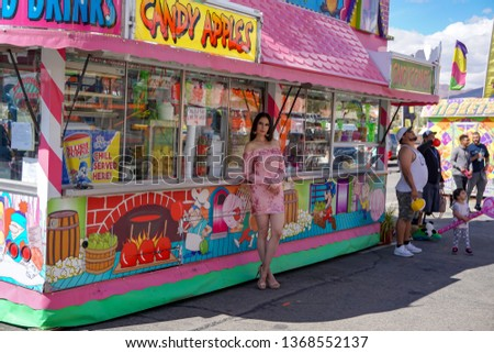 El Paso, Texas / USA - 13 April 2019:  Unidentified beautiful young woman posing at a carnival. #1368552137