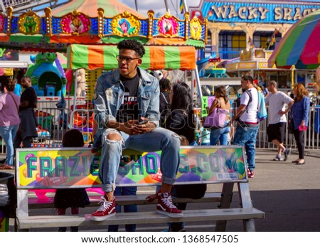 El Paso, Texas / USA - 13 April 2019:  Unidentified people having a good time at a carnival. #1368547505