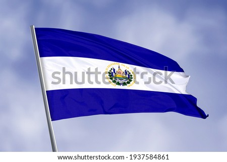El Salvador flag isolated on sky background. close up waving flag of El Salvador. flag symbols of El Salvador.
