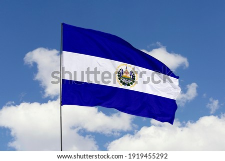 El Salvador flag isolated on the blue sky with clipping path. close up waving flag of El Salvador. flag symbols of El Salvador.