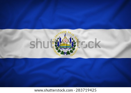 El Salvador flag on the fabric texture background,Vintage style