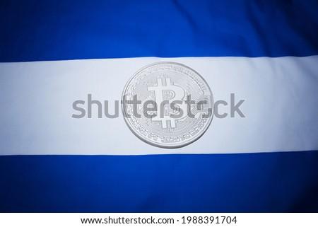 El Salvador flag with bitcoin. El Salvador as first country adopting bitcoin as legal tender concept.