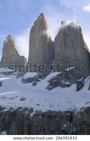 El Torres del Paine, Chile. The three towers with snow in late afternoon. Clear sky.