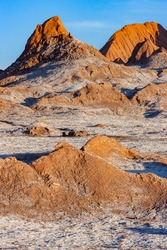 El Valle de la Luna (Valley of the Moon) near San Pedro de Atacama in the Cordillera de la Sal region of the Atacama desert in northern Chile, South America. The white areas are salt deposits.