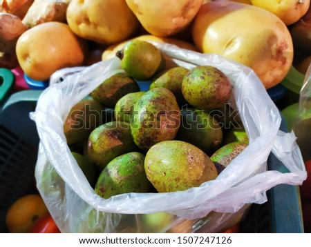 Elaeocarpus hygrophilus, in a plastic bag, mostly found in Vietnam and Thailand. Its taste is sour.