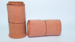 Elastic bandage, which is a type of roll bandage that can adjust to the shape of the body. This bandage is flexible and can put pressure around the wound to reduce pain and swelling.