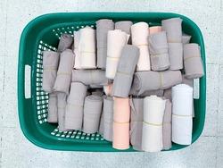Elastic bandages in basket on floor.Medical bandages roll.