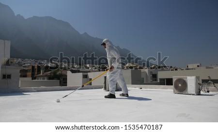 Elastomeric roof coating in roof top