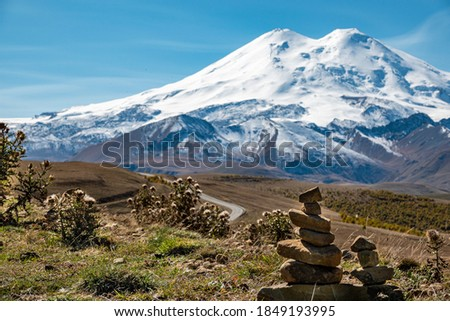 Elbrus And Green Hills At Sunny Summer Day. Elbrus Region, North Caucasus, Russia