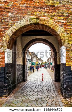 Elburg, the Netherlands - Oct. 25, 2014: The centuries old Vischpoort or Fish Gate in the historic Dutch fishing village of Elburg  #1156446529
