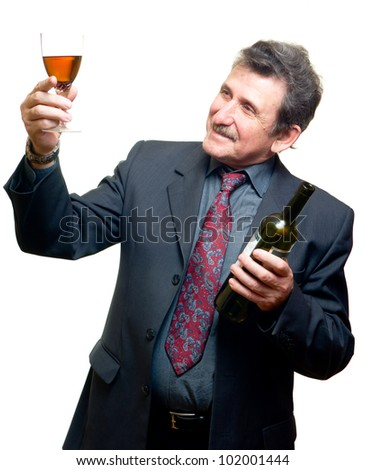 Elder businessman with glass of red wine isolated on white