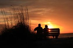 Elder couple watching sunset
