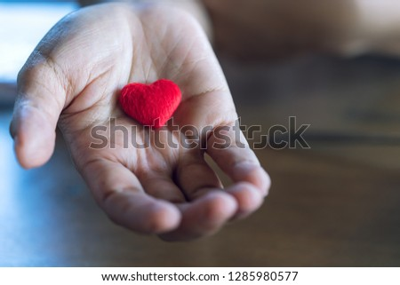 Elder Female hands giving little red heart , Love and care concept #1285980577