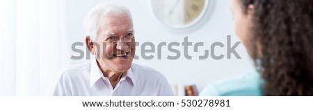 Elder man is spending happy time with his company