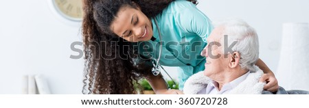 Elder man's health is very important for young nurse  #360720728