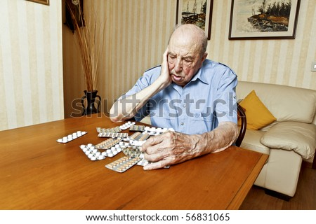 elder man with pills