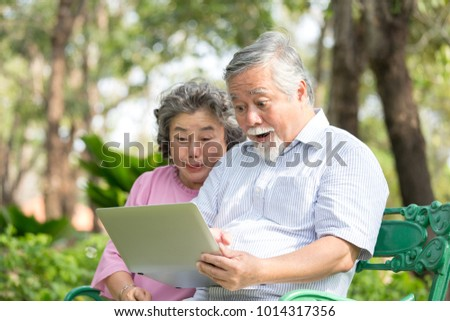 Elder people using laptop with excited emotion together. People lifestyle concept. #1014317356