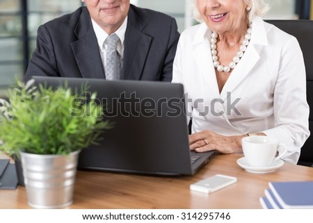 Elder smart business people know how to use computer