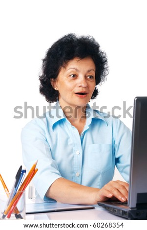 Elder surprised woman using laptop on white background.